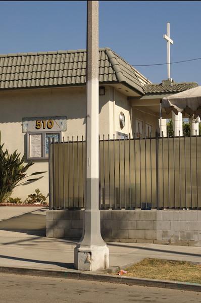 St.Bridget'sChineseCatholicCenter020-NorthSideDisplayCaseAndCross-2006-9-18