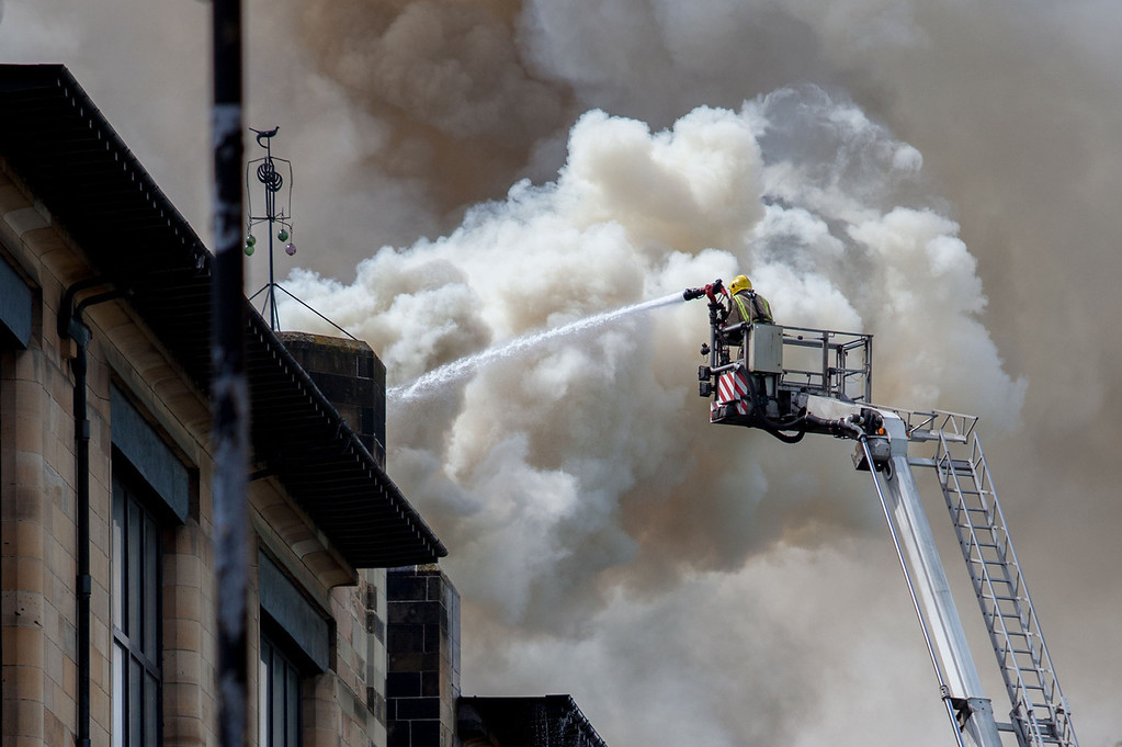 ". In this photo released by David Barz , firefighters attend a fire at  Glasgow School of Art, Glasgow, Scotland, Friday, May 23, 2014.    A major fire has devastated the Glasgow School of Art, one of the city\'s major landmarks. The Scottish Fire and Rescue Service said the blaze, which broke out just after noon on Friday, was a ""very significant fire.\"" Flames flared through the roof and windows of the sandstone Art Nouveau building, designed by architect Charles Rennie Mackintosh and completed in 1909. A 2009 poll by the Royal Institute of British Architects voted it the best British building of the last 175 years. (AP Photo / David Barz)"