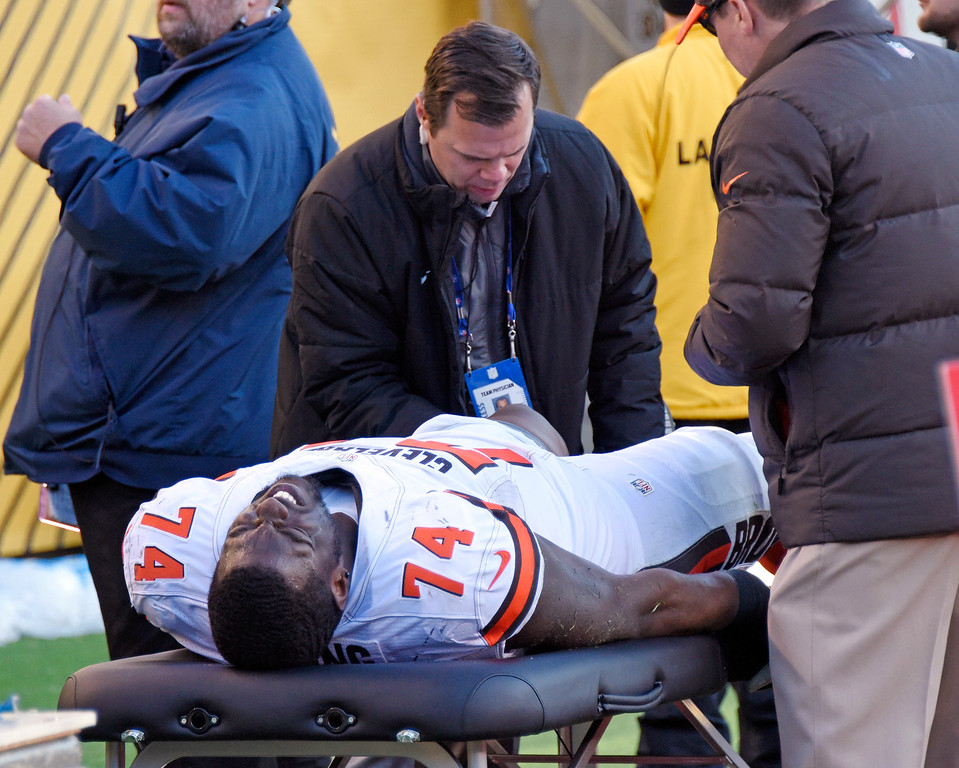 . Cleveland Browns center Cameron Erving (74) is examined after being injured during the second half of an NFL football game against the Pittsburgh Steelers in Pittsburgh, Sunday, Jan. 1, 2017. (AP Photo/Don Wright)