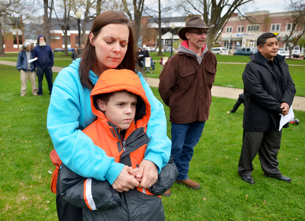 . Jeff Forman/JForman@News-Herald.com Angela Hytree hugs her son Turner, 9, during a National Day of Prayer observance May 1 in Painesville. They live in Painesville.