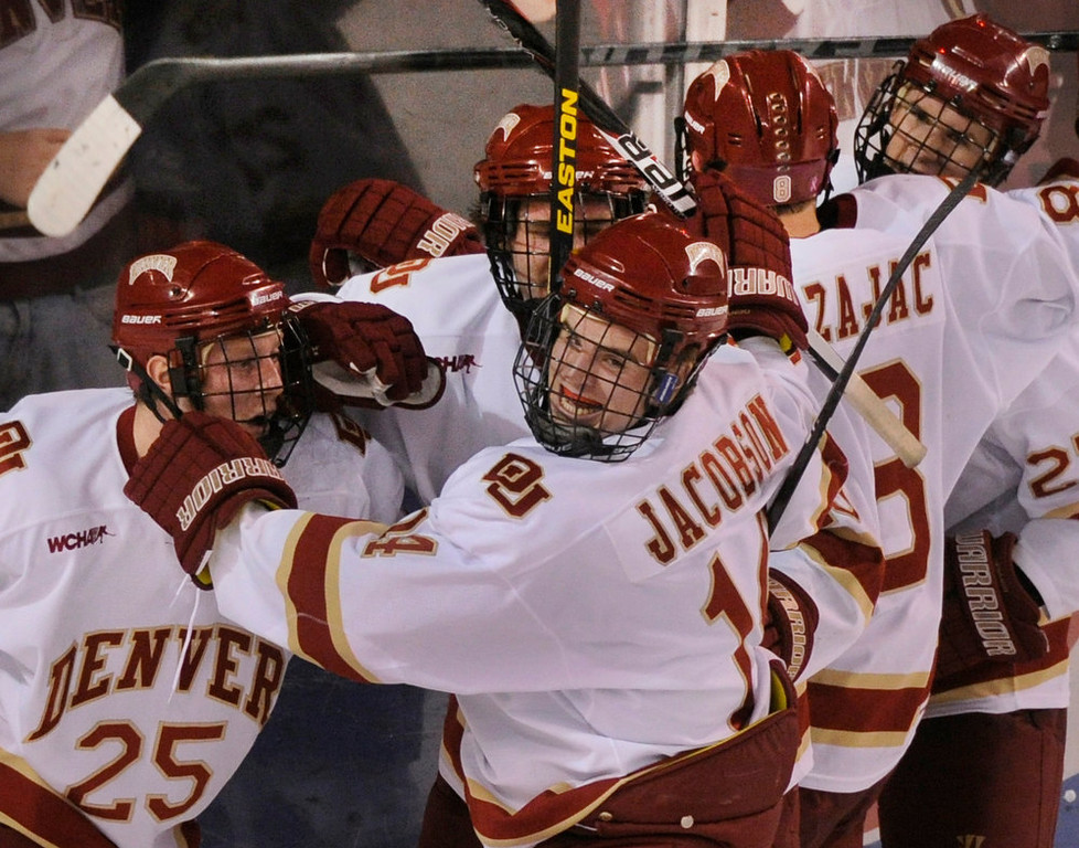. Denver wing Larkin Jacobson celebrated the tie-breaking goal in the third period with linemates. It was Jacobson\'s first college goal. The University of Denver hockey team defeated Cornell 2-1 at Magness Arena Saturday night, January 5, 2013. Karl Gehring/The Denver Post