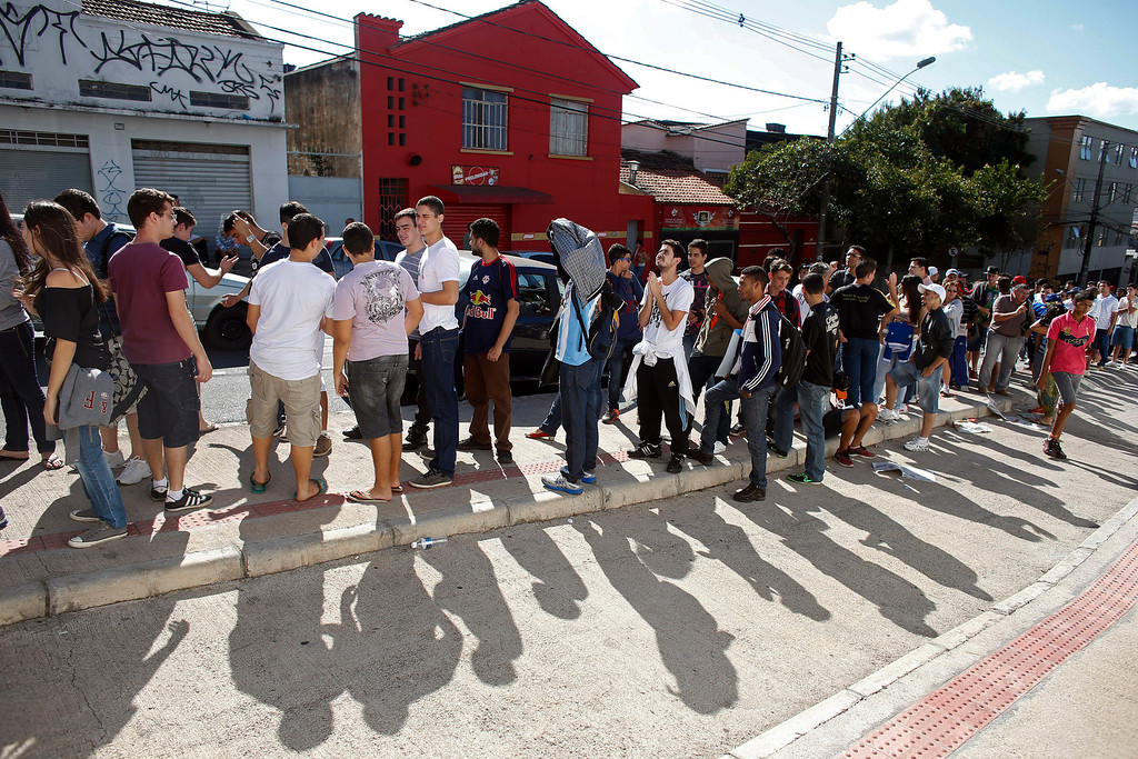 . People line up outside Independencia Stadium for free tickets to watch a practice session by Argentina\'s soccer team in Belo Horizonte, Brazil, Tuesday, June 10, 2014. The World Cup starts on June 12. (AP Photo/Victor R. Caivano)