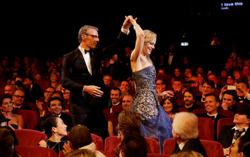 . Master of Ceremonies Lambert Wilson, left, and actress Nicole Kidman during the opening ceremony ahead of the screening of Grace Of Monaco at the 67th international film festival, Cannes, southern France, Wednesday, May 14, 2014. (AP Photo/Thibault Camus)
