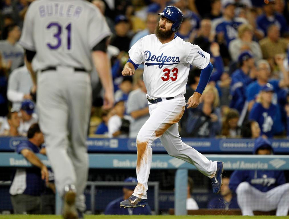 . Los Angeles Dodgers Scott Van Slyke (33) scores on a hit by Matt Kemp in the fifth inning of a baseball game against the Colorado Rockies on Saturday, Sept. 27, 2014, in Los Angeles. (AP Photo/Alex Gallardo)