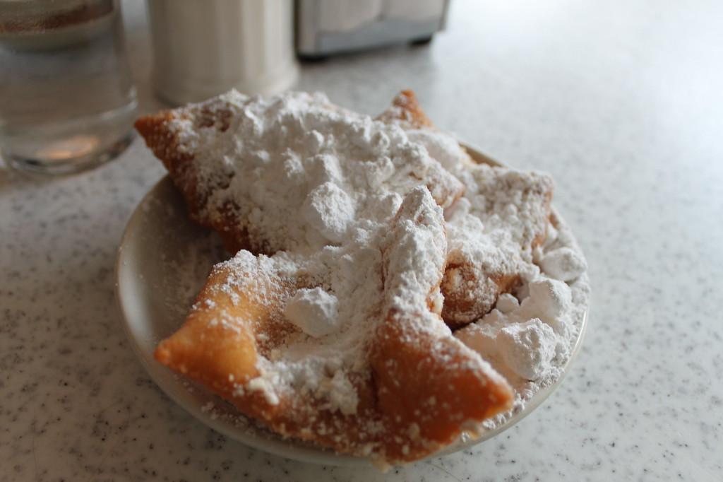 Beignets covered in powdered sugar at Cafe du Monde
