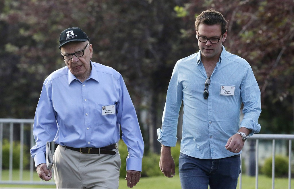 . Rupert Murdoch, left, Chairman and CEO of News Corporation, walks with his son James Murdoch, right, at the Allen & Company Sun Valley Conference in Sun Valley, Idaho, Wednesday, July 10, 2013. (AP Photo/Rick Bowmer)