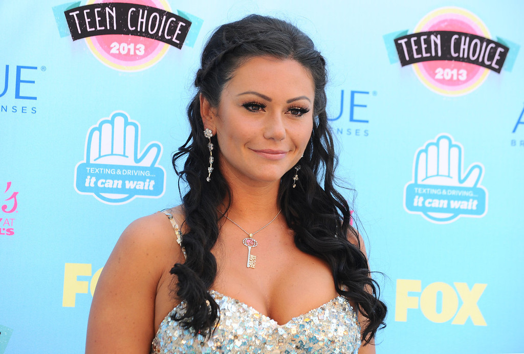 """. Jenni \""""Jwoww\"""" Farley arrives at the Teen Choice Awards at the Gibson Amphitheater on Sunday, Aug. 11, 2013, in Los Angeles.  (Photo by Jordan Strauss/Invision/AP)"""