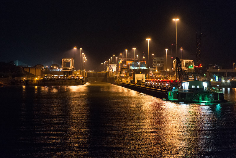 Entering the Panama Canal in Panama City at night.