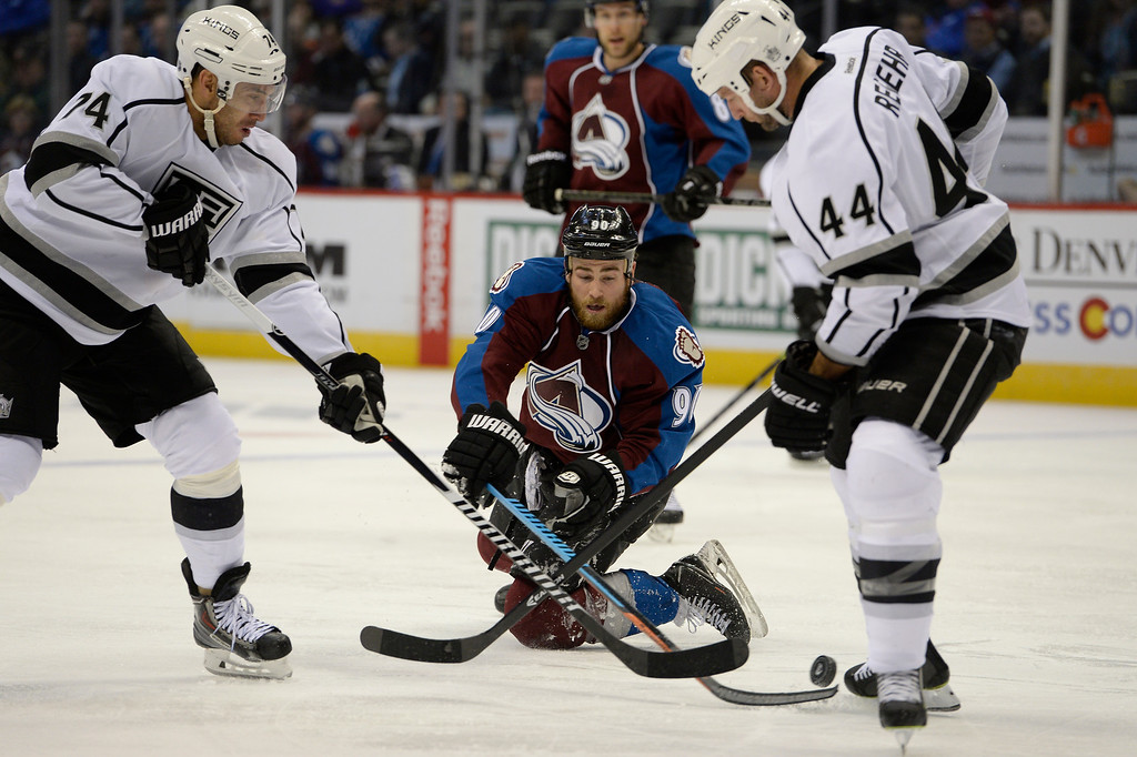 . DENVER, CO - FEBRUARY 18: Colorado Avalanche center Ryan O\'Reilly (90) press at the puck from his knees as Los Angeles Kings left wing Dwight King (74) and Los Angeles Kings defenseman Robyn Regehr (44) come in on defense during the third period February 18, 2015 at Pepsi Center. (Photo By John Leyba/The Denver Post)