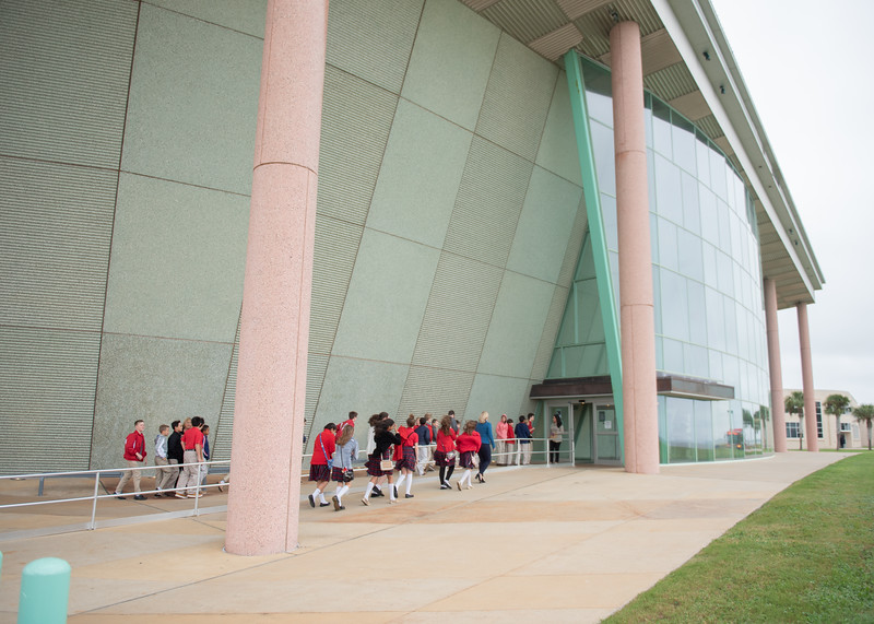 Students from Incarnate Ward Academy make their way into the TAMU-CC Performing Arts Center.