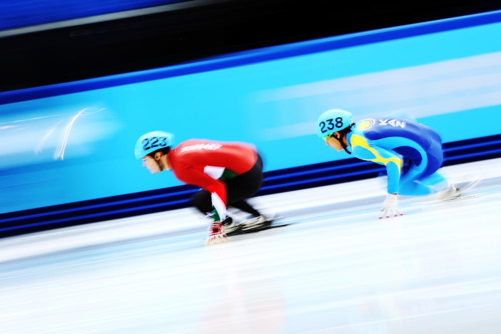 . Viktor Knoch of Hungary and Nurbergen Zhumagaziyev of Kazakhstan compete in the Short Track Men\'s 500m Heat at Iceberg Skating Palace on day 11 of the 2014 Sochi Winter Olympics on February 18, 2014 in Sochi, Russia.  (Photo by Paul Gilham/Getty Images)