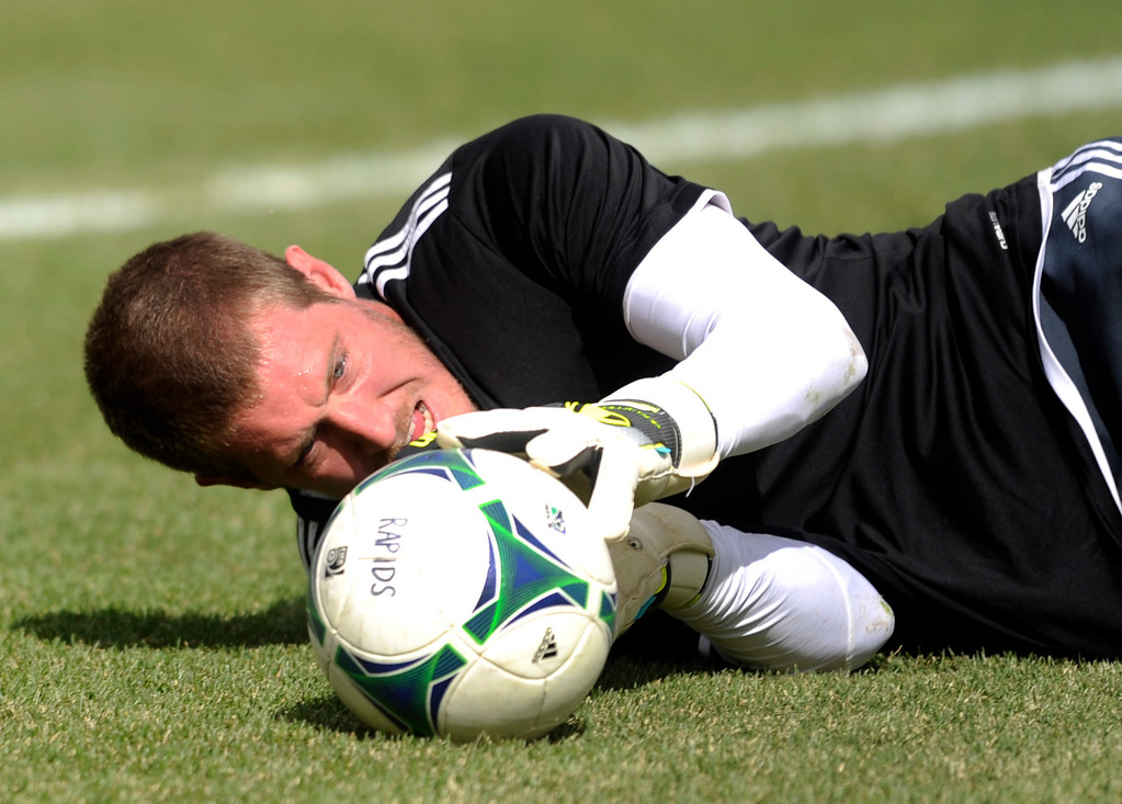 . Clint Irwin (31) of the Colorado Rapids warmed up before the game. The Colorado Rapids hosted the Portland Timbers Saturday, March 30, 2013 at Dick\'s Sporting Goods Park in Commerce City.  Photo By Karl Gehring/The Denver Post)