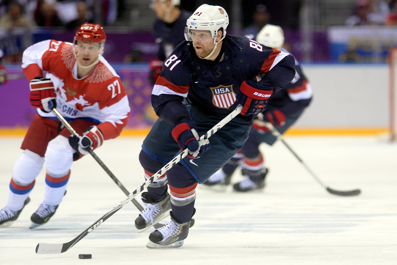 . Phil Kessel (81) of the U.S.A. controls the puck as Alexei Tereshenko (27) of the Russia pursues during  the third period of the U.S.A.\'s shootout-win at Bolshoy arena. Sochi 2014 Winter Olympics on Saturday, February 15, 2014. (Photo by AAron Ontiveroz/The Denver Post)
