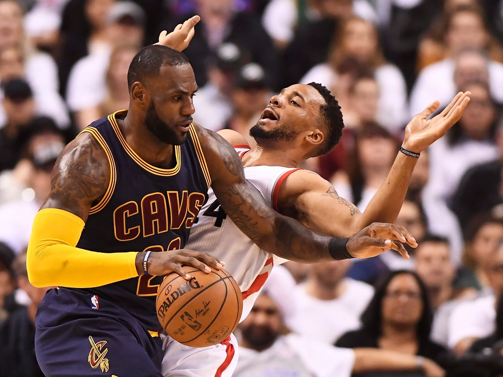 . Cleveland Cavaliers forward LeBron James (23) drives against Toronto Raptors guard Norman Powell (24) during the first half of Game 3 of an NBA basketball second-round playoff series in Toronto on Friday, May 5, 2017. (Frank Gunn/The Canadian Press via AP)