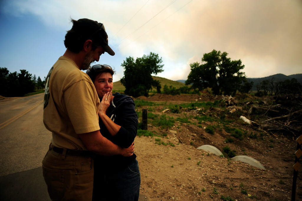 . Pat and Lori Tovaas hug upon finding that their trailer had not burned down in Rist Canyon as the High Park fire west of Fort Collins and Loveland continues to burned on Monday, June 11, 2012. The fire has now burned more than 35,000 acres encompassing more than 60 square miles. AAron Ontiveroz, The Denver Post
