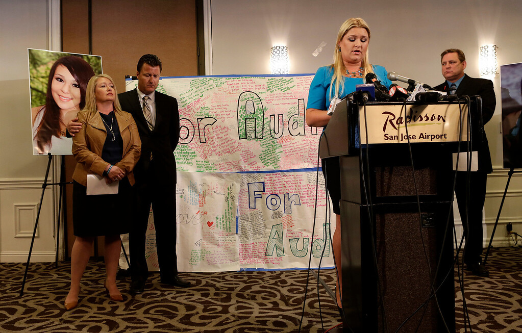 . Lisa Pott, Audrie Pott\'s stepmother, addresses the media as the family speaks for the first time about the tragic death of the 15-year-old Saratoga High School student, at a news conference in San Jose, Calif., on Monday, April 15, 2013.  At left is Audrie\'s mother Sheila Pott, attorney Robert Allard and father Larry Pott. Audrie Pott committed suicide last September following an alleged sexual assault by three 16-year-old classmates. (Gary Reyes/Bay Area News Group)
