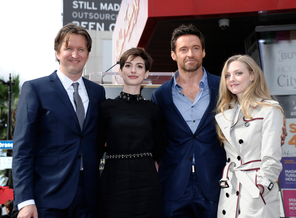 Description of . From left to right, director Tom Hooper, actress Anne Hathaway, actor Hugh Jackman, and actress Amanda Seyfried attend Jackman's star ceremony at the Hollywood Walk of Fame on Thursday, Dec. 13, 2012, in Los Angeles. (Photo by Dan Steinberg/Invision/AP)
