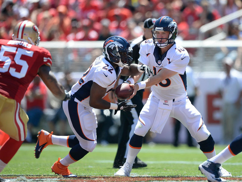 . Denver Broncos quarterback Peyton Manning (18) hands off wot Denver Broncos running back C.J. Anderson (22) during the second quarter against the San Francisco 49ers outside linebacker Ahmad Brooks (55) August 17, 2014 at Levi\'s Stadium. (Photo by John Leyba/The Denver Post)