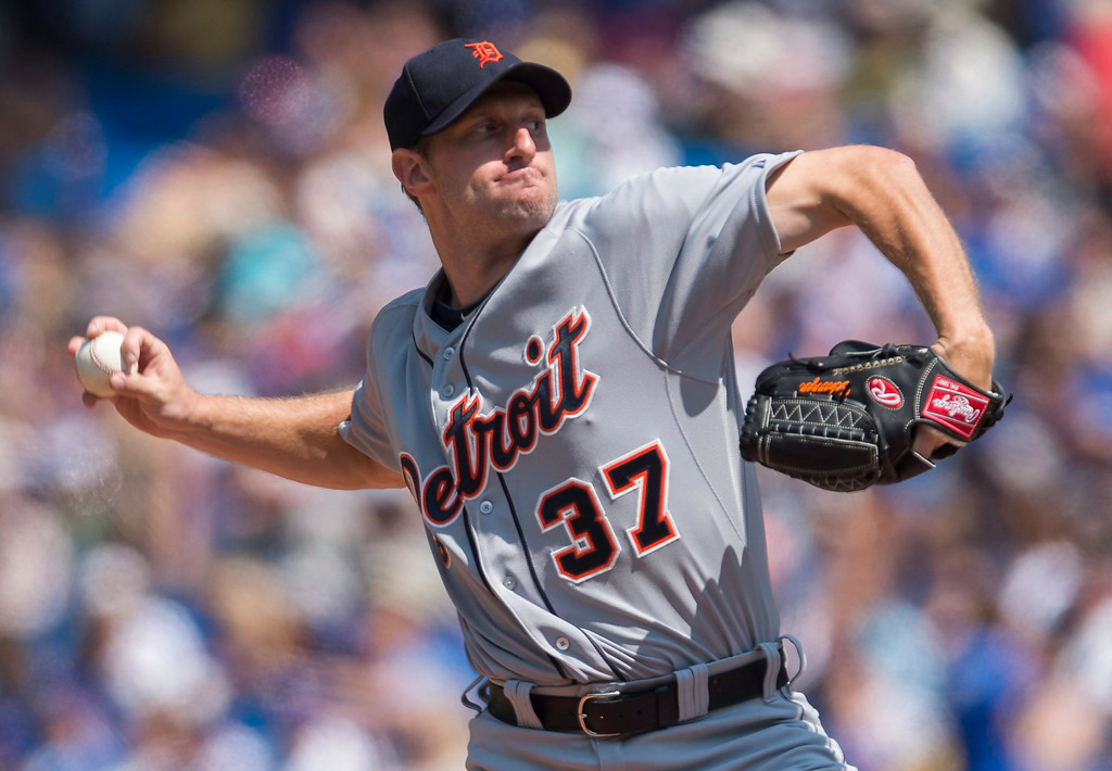 . Detroit Tigers starting pitcher Max Scherzer works against the Toronto Blue Jays during the first inning of a baseball game in Toronto on Saturday, Aug. 9, 2014. (AP Photo/The Canadian Press, Darren Calabrese)