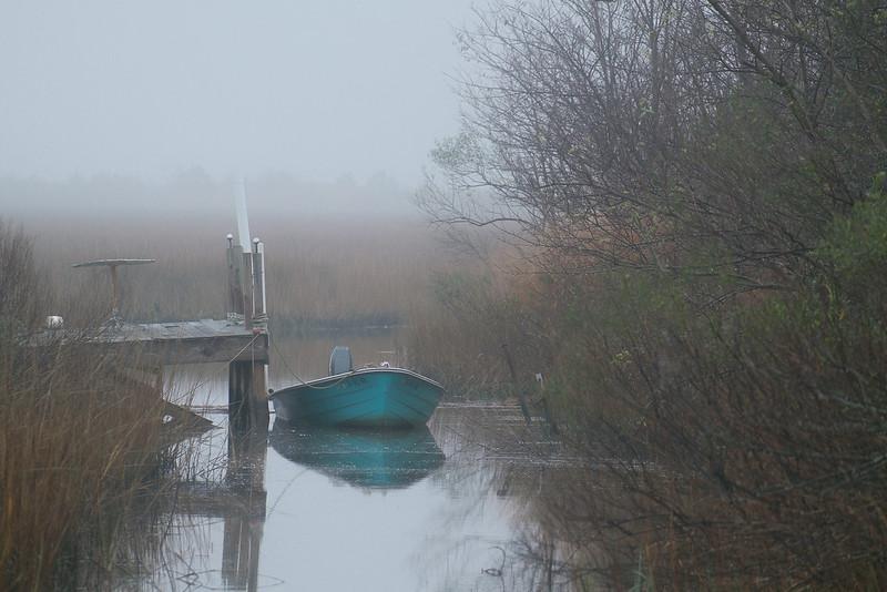 Blue Boat on Foggy Morning