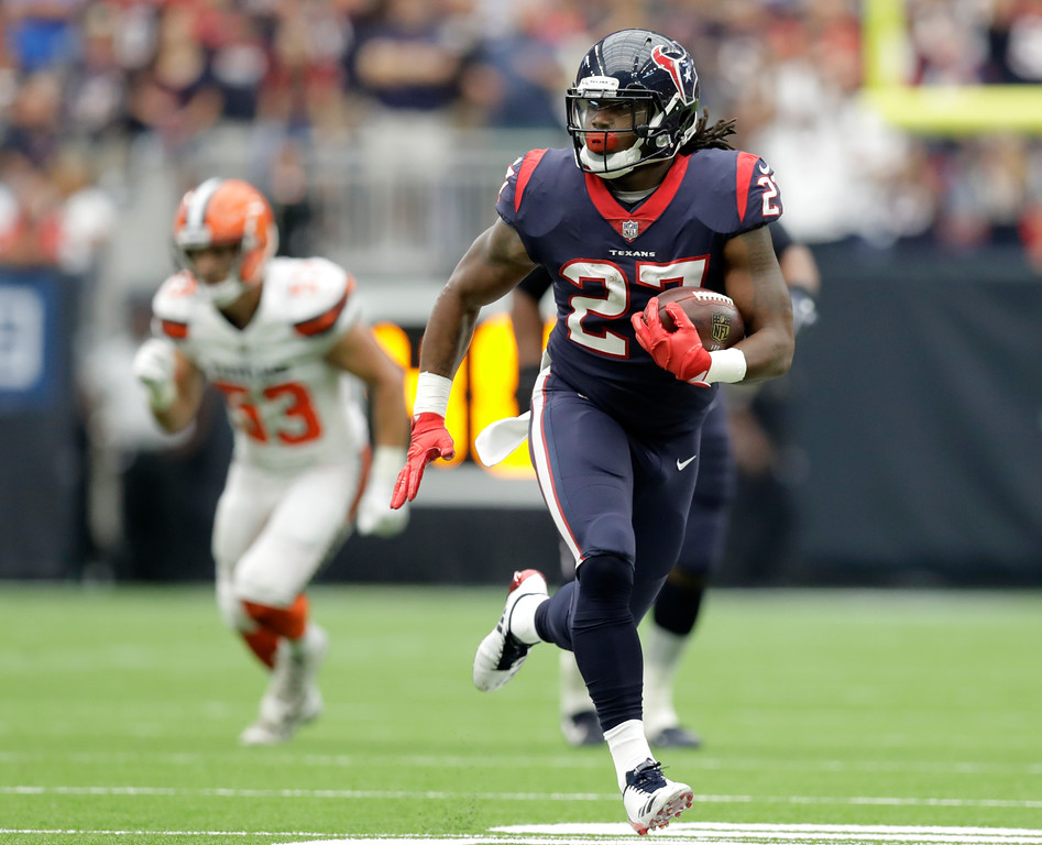 . Houston Texans running back D\'Onta Foreman (27) breaks out for a long run against the Cleveland Browns in the first half of an NFL football game, Sunday, Oct. 15, 2017, in Houston. (AP Photo/Eric Gay)