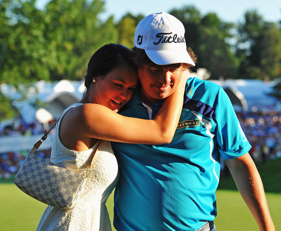 . Jason Dufner of the United States hugs his wife Amanda after his two-stroke victory at the 95th PGA Championship at Oak Hill Country Club on August 11, 2013 in Rochester, New York.  (Photo by Stuart Franklin/Getty Images)