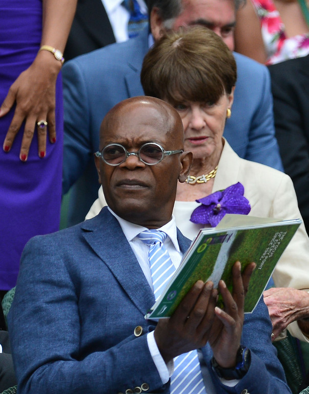. US actor Samuel L Jackson sits in the Royal Box on Centre Court before the start of the men\'s singles final match between Serbia\'s Novak Djokovic and Switzerland\'s Roger Federer on day thirteen of the 2014 Wimbledon Championships at The All England Tennis Club in Wimbledon, southwest London, on July 6, 2014.  CARL COURT/AFP/Getty Images