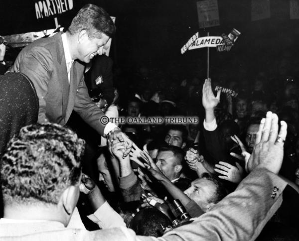 . Oakland, CA November 2, 1960 - Presidential candidate Senator John F. Kennedy greets supporters at de Fremery Park in West Oakland. (Leo Cohen / Oakland Tribune Staff Archives)