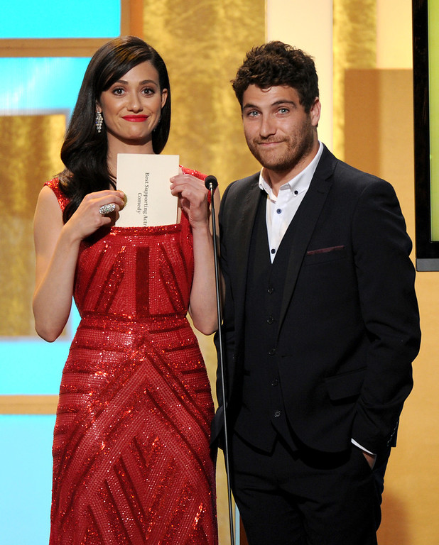 . Emmy Rossum, left, and Adam Pally speak on stage at the Critics\' Choice Television Awards in the Beverly Hilton Hotel on Monday, June 10, 2013, in Beverly Hills, Calif. (Photo by Frank Micelotta/Invision/AP)