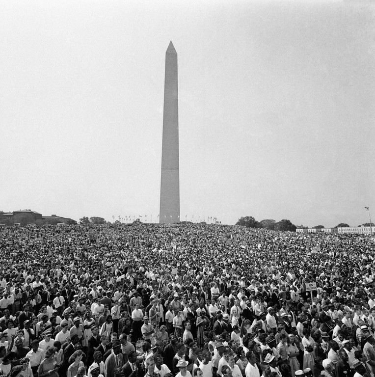 . Mass of demonstrators leave the Washington Monument, background, for the March on Washington parade to the Lincoln Memorial, Aug. 28, 1963. (AP Photo)