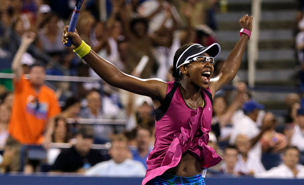 . Victoria Duval, of the United States, raises her arms in celebration after defeating Samantha Stosur, of Australia, in the first round of the 2013 U.S. Open tennis tournament, Tuesday, Aug. 27, 2013, in New York. Duval won 5-7, 6-4, 6-4. (AP Photo/Charles Krupa)