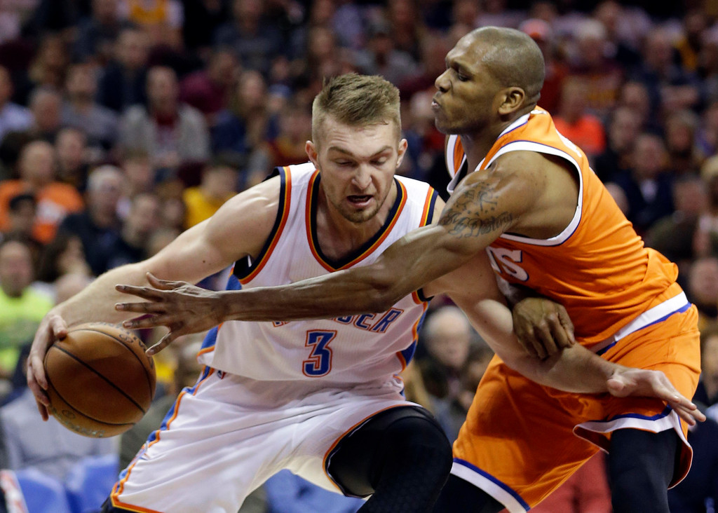 . Oklahoma City Thunder\' Domantas Sabonis (3) drives against Cleveland Cavaliers\' James Jones (1) in the second half of an NBA basketball game, Sunday, Jan. 29, 2017, in Cleveland. (AP Photo/Tony Dejak)
