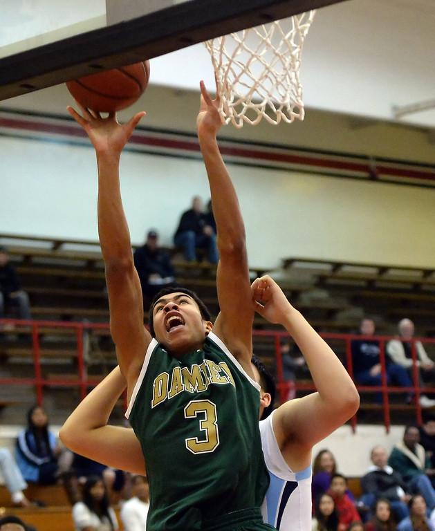 . Damien\'s Thaddeus Smith (3) drives to the basket against Walnut in the first half of the Glendora basketball tournament at Glendora High School in Glendora, Calif., on Friday, Dec. 13, 2013. Damien won 66-60.  (Keith Birmingham Pasadena Star-News)