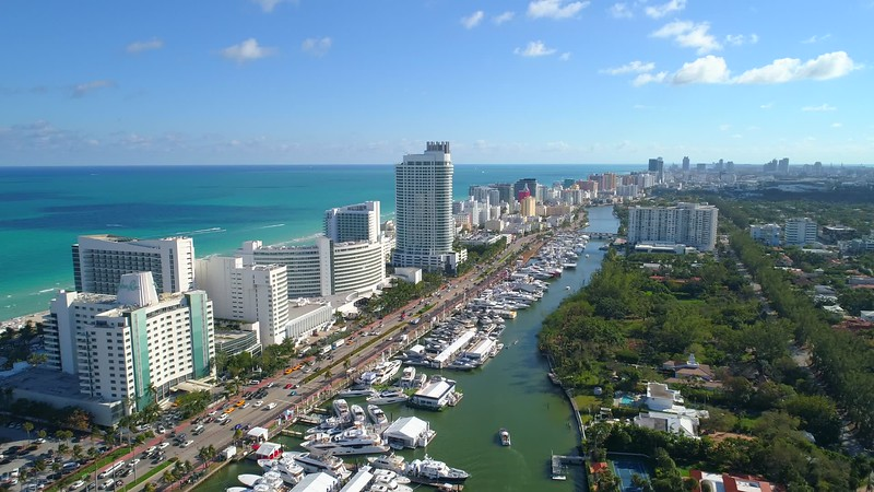Aerial approach flyover and tilt down camera Miami Beach Fontainebleau Hotel 4k