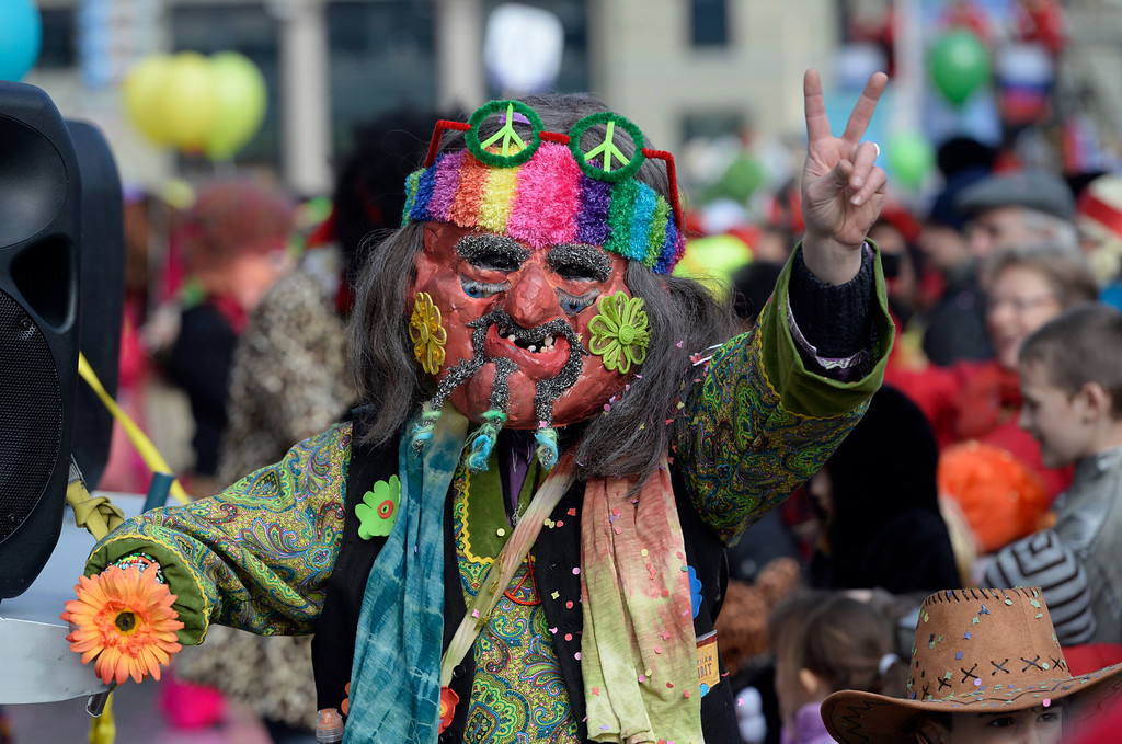 . Masked revelers tour through the streets during the start of the carnival season in Lucerne, Switzerland, Thursday, Feb. 27, 2014. (AP Photo/Keystone, Urs Flueeler)
