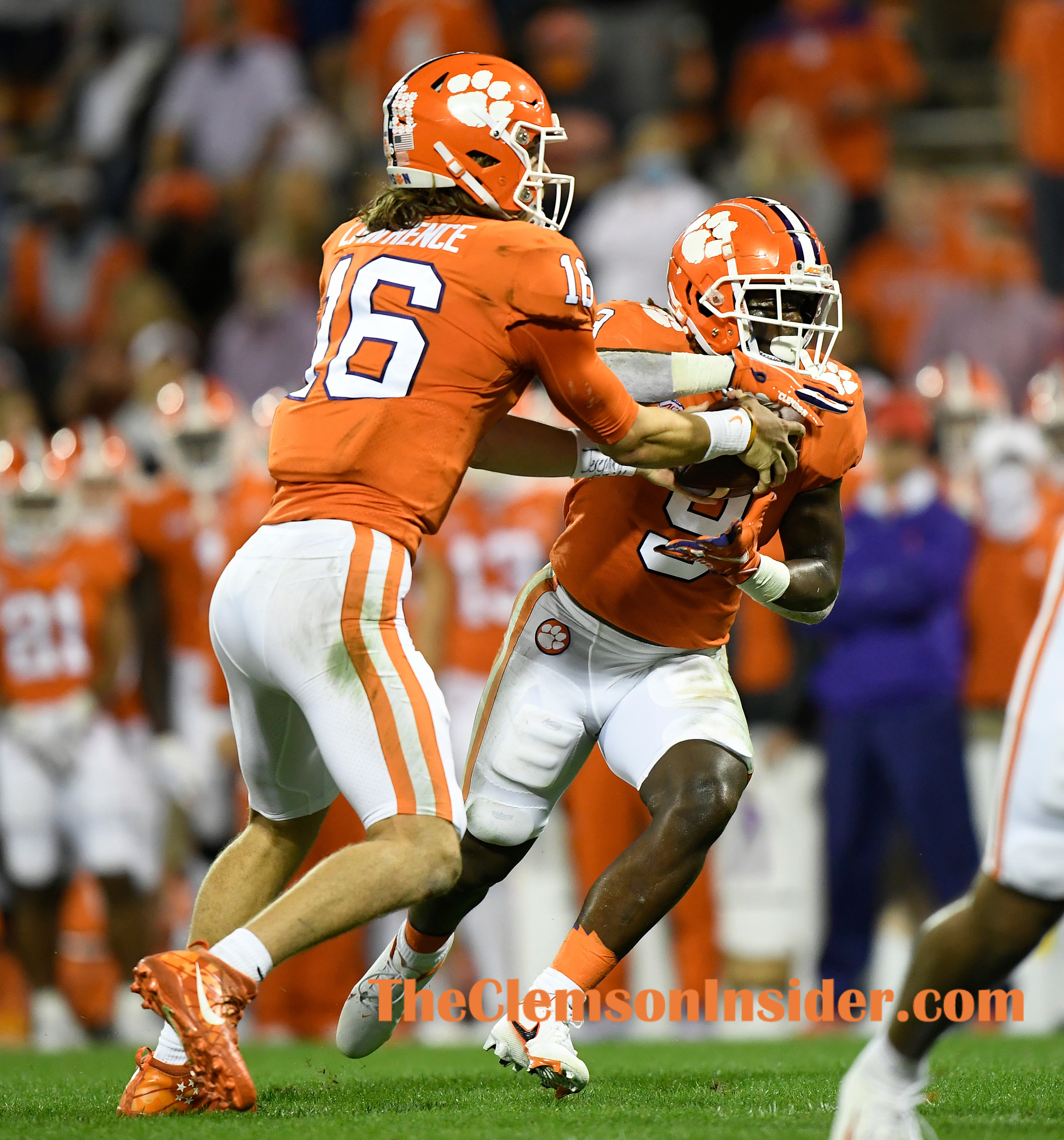 Clemson quarterback Trevor Lawrence (16) hands off to running back Travis Etienne (9) during the 2nd quarter of Clemson's game against the University of Miami at Clemson's Memorial Stadium Saturday, October 10, 2020. Bart Boatwright/The Clemson Insider