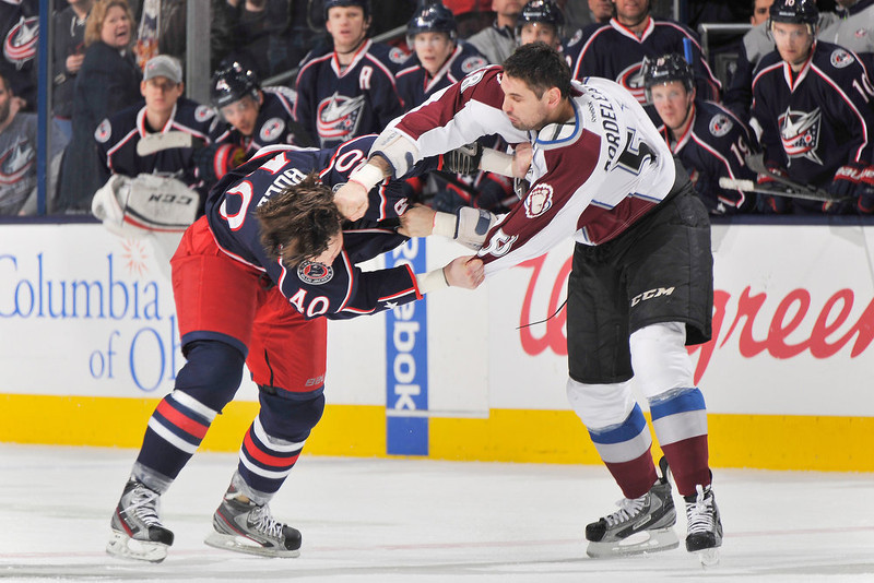 . Jared Boll #40 of the Columbus Blue Jackets and Patrick Bordeleau #58 of the Colorado Avalanche fight in the second period on March 3, 2013 at Nationwide Arena in Columbus, Ohio. Columbus defeated Colorado 2-1 in overtime.  (Photo by Jamie Sabau/NHLI via Getty Images)