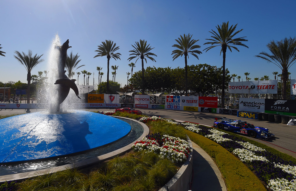. TUDOR Championship driver Oswaldo Negri makes the turn around the aquarium fountain in Long Beach, CA on Friday, April 17, 2015. The 40th annual Toyota Grand Prix of Long Beach kicked off with practices for all of the racing divisions. (Photo by Scott Varley, Daily Breeze)