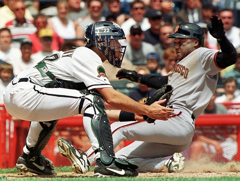 . Milwaukee Brewers catcher Mike Matheny waits for a throw as  San Francisco Giants Darryl Hamilton slides safely home in the sixth inning Thursday, May 21, 1998, in Milwaukee. Hamilton scored from first on a double by Bill Mueller.  (AP Photo/Morry Gash)