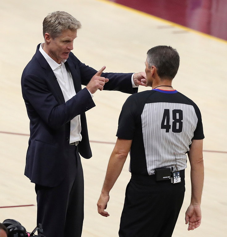 . Golden State Warriors coach Steve Kerr talks with referee Scott Foster during the second half of Game 4 of basketball\'s NBA Finals against the Cleveland Cavaliers, Friday, June 8, 2018, in Cleveland. (AP Photo/Carlos Osorio)