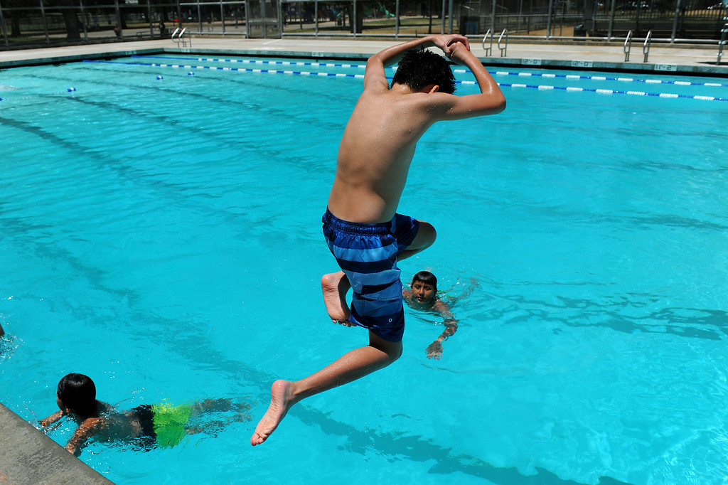 """. Matthew Susanto, 13, does the \""""margarita\"""" dive at the Lanark Park pool in Canoga Park, Saturday, June 14, 2014. (Photo by Michael Owen Baker/Los Angeles Daily News)"""