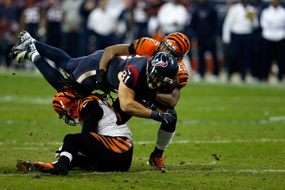 . Owen Daniels #81 of the Houston Texans makes a catch against Nate Clements #22 of the Cincinnati Bengals during their AFC Wild Card Playoff Game at Reliant Stadium on January 5, 2013 in Houston, Texas.  (Photo by Scott Halleran/Getty Images)