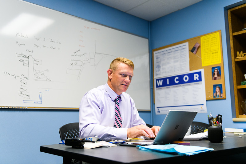 McNary principal Erik Jespersen responds to over one hundred e-mails in his office. Back to school day at McNary High School on Wednesday, September 4, 2019 in Keizer, Ore.