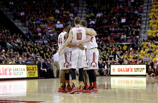 . Maryland guard/forward Jake Layman (10) huddles with teammates in the second half of an NCAA college basketball game against Michigan, Saturday, Feb. 28, 2015, in College Park, Md. (AP Photo/Patrick Semansky)