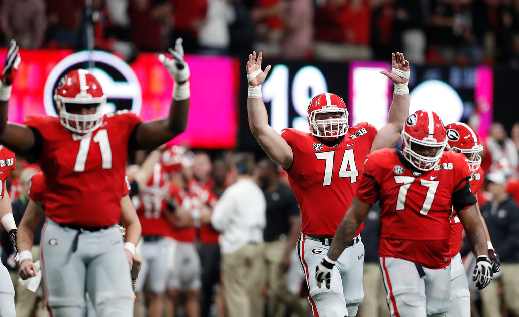 . Georgia react after a replay confirmed a touchdown during the second half of the NCAA college football playoff championship game against Alabama Monday, Jan. 8, 2018, in Atlanta. (AP Photo/David Goldman)