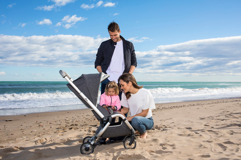 Mima_Zigi_Lifestyle_Charcoal_On_Beach_Looking_At_Stroller.jpg