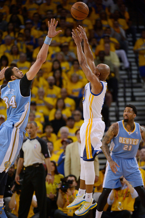 . Jarrett Jack (2) of the Golden State Warriors takes a shot over JaVale McGee (34) of the Denver Nuggets during the second quarter in Game 6 of the first round NBA Playoffs May 2, 2013 at Oracle Arena. (Photo By John Leyba/The Denver Post)