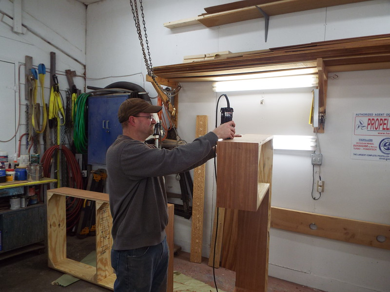 Trimming the Mahogany skin that covers the desk base.