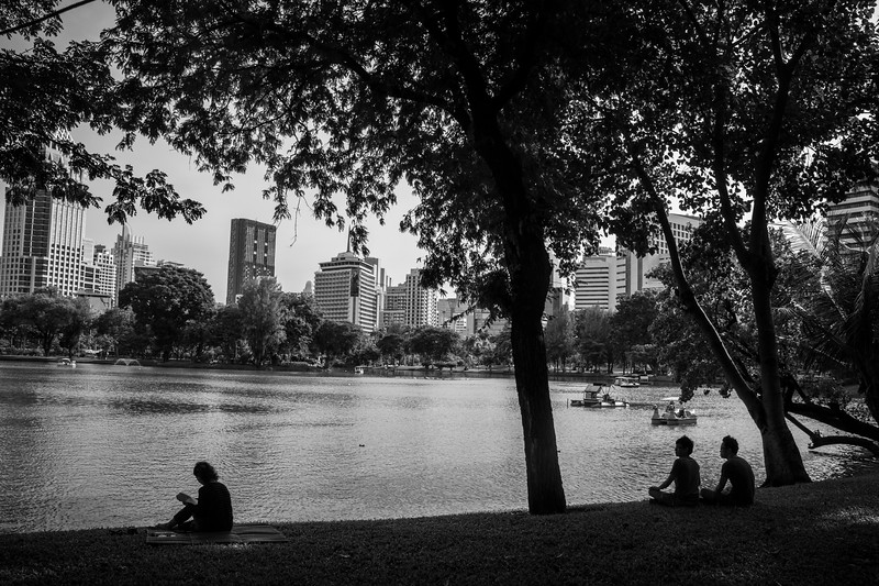Stunning cityscape and lovely urban life scene captured at Lumphini Park.