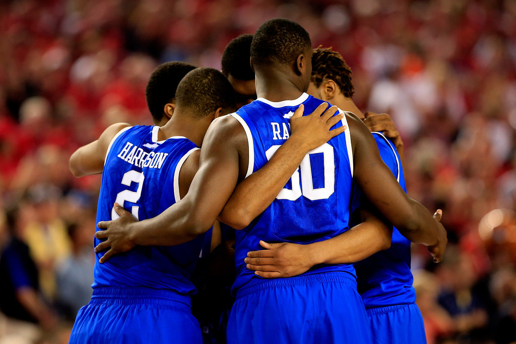 . ARLINGTON, TX - APRIL 05: The Kentucky Wildcats huddle before the NCAA Men\'s Final Four Semifinal against the Wisconsin Badgers at AT&T Stadium on April 5, 2014 in Arlington, Texas.  (Photo by Jamie Squire/Getty Images)